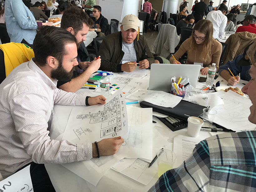 Sal Forgione (far left) of Michael Graves Architecture & Design works alongside student designers.